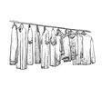 Hand drawn clothes on the hangers vector image