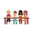 children sitting at table eating at camp vector image vector image