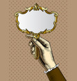 womans hand with a gold retro mirror vector image