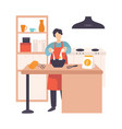 man breaks an egg in a bowl in a modern kitchen vector image