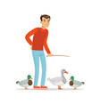 farmer man feeding ducks poultry breeding vector image vector image