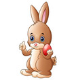 cute little bunny giving a thumb up with holding r vector image vector image