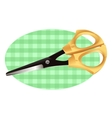Scissors on a checkered cloth vector image