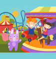 two young children having fun at fairground vector image