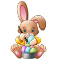 cartoon rabbit painting an eggs vector image vector image