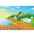 A boy feeding the sheeps vector image vector image