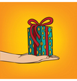 Outstretched hand with gift box vector image vector image