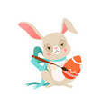 cute cartoon bunny with blue bow with egg funny vector image vector image