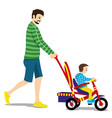 father and child on a tricycle vector image vector image