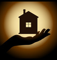 silhouette of the house on the hand vector image vector image