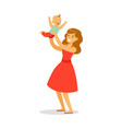 beautiful young mother in red dress with her vector image vector image