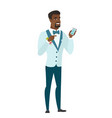 african-american groom holding a mobile phone vector image vector image