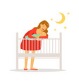 young mother in red dress putting her newborn baby vector image vector image