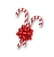 holiday red bow candy canes on white background vector image