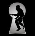 silhouette a thief seen through a keyhole vector image