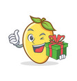 mango character cartoon mascot with gift vector image vector image
