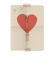 broken heart painted on the sheet of a notebook vector image
