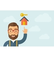 Man pointin the house with key icon vector image