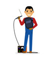 cartoon welder with a welding machine vector image