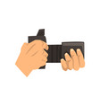 hands holding photo camera on vector image vector image