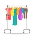Rolling hanger rack with women clothes collection vector image