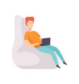 young man sitting on chair and working vector image