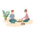 woman and man play chess together family game vector image