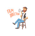 film director sitting in his chair speaking into a vector image vector image