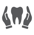 hands holding tooth glyph icon stomatology vector image