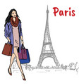 woman with shopping bags in paris vector image