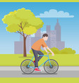 man rides bicycle along road with city on horizon vector image vector image