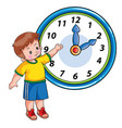 Boy stands next to a large clock and shows it