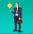 pop art businessman with creative idea light bulb vector image vector image
