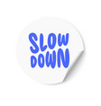 white sticker with slow down text hand lettering vector image