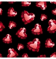 Shiny red ruby heart on black background seamless vector image