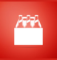 pack of beer bottles icon on red background vector image vector image