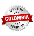 made in colombia silver badge with red ribbon vector image vector image