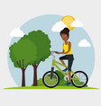 young black woman riding bicycle vector image