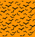 seamless pattern orange background with bat vector image vector image
