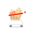 shopping cart with paper bag on white background vector image vector image
