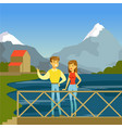 young man and woman standing on the bridge in the vector image
