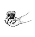 hand holding a shot of espresso coffee vector image