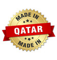 made in Qatar gold badge with red ribbon vector image vector image
