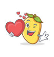 mango character cartoon mascot with heart vector image vector image