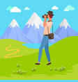 photographer taking pictures mountain view vector image vector image