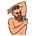 bearded hipster man shaves his armpit with a razor vector image vector image