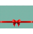 Christmas background with polka dots and red bow vector image vector image