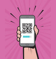 hand holding a phone with qr code on screen vector image