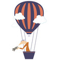 young man with a camera flying on the air balloon vector image