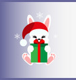 bunny with a gift in a christmas cap icon stiker vector image vector image